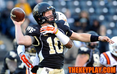 Wake Forest Demon Deacons quarterback John Wolford (10) is hit from behind by Virginia Tech Hokies cornerback Chuck Clark (19). (Michael Shroyer/ Thekeyplay.com)