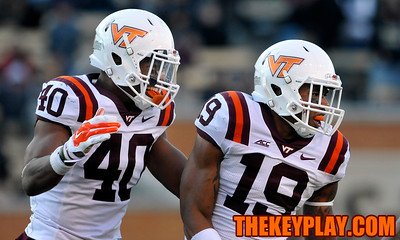 Virginia Tech Hokies linebacker Deon Clarke (40) and cornerback Chuck Clark (19) celebrate Clark's quarterback hit. (Michael Shroyer/ Thekeyplay.com)