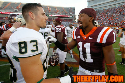 Kendall Fuller (11) talks with Sean Ballard (83) after the game.