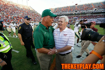 Virginia Tech head coach Frank Beamer (right) talks with William and Mary head coach Jimmye Laycock after the game.