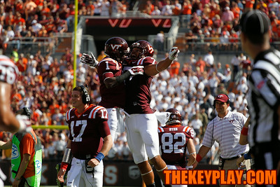 Isaiah Ford (1) celebrates his first touchdown with Bucky Hodges (7).