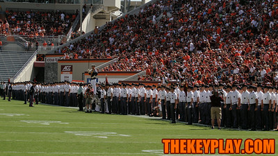 The Corps of Cadets stand at attention before the national anthem.