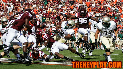 Corey Marshall (96) leaps into the air as the rest of the VT defense swarms Mikal Abdul-Saboor of William & Mary