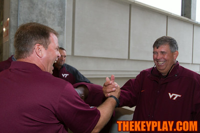 Bryan Stinespring (left) and Charley Wiles (right) share a laugh as media day winds down.