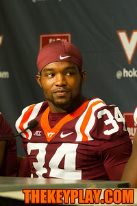 Kyshoen Jarrett looks at one of his teammates as they answer a question at media day.