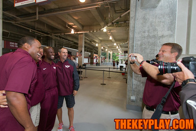 Bryan Stinespring (right) takes a photo of the other coaches.
