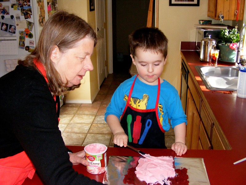 Nate baked a birthday cake for Anna with Daddy and then frosted it with Nonni - red velvet cake and pink frosting, his choices...