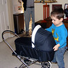 Nate gets special big brother gift from Nonni & Papa - a stroller for his baby doll Isabel