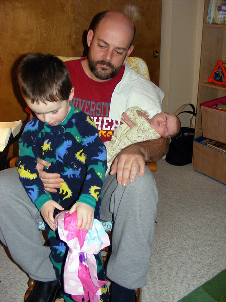 Nate opening the present he chose for Anna before she was born - a ballerina