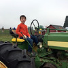 tractor driving at pumpkin patch