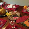 Anna's gold painted pumpkin and Nate's potato-and-marshmallow turkey feature as centerpieces