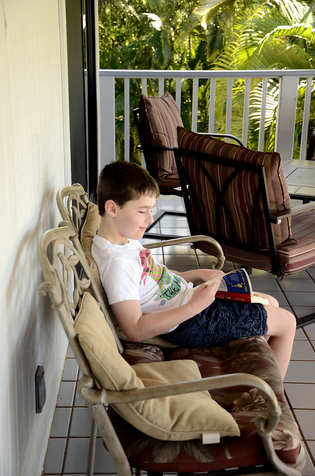 Change of scene - reading out on the lanai while we wait for Nonni & Papa to arrive