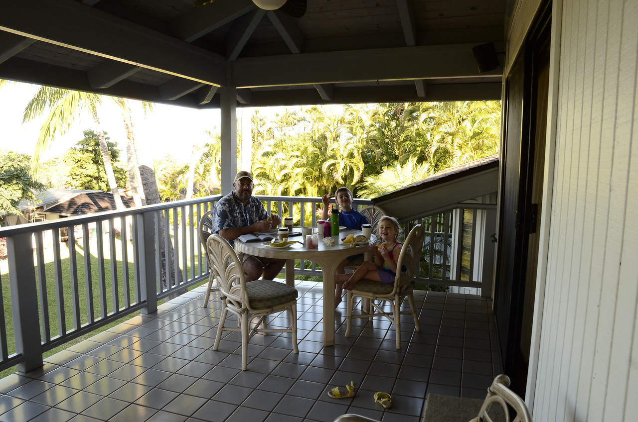 Morning #2 - the first of a daily breakfast tradition out on the lanai, with birds singing all around us, roosters crowing, and the ocean visible in the distance,