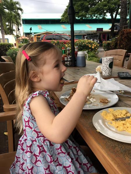 Anna enjoys her own pancake shaped like a whale!
