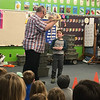 Nate volunteers to hold the snake when the reptile man comes to his classroom!