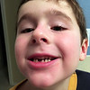 First lost tooth!  Pulled by Daddy at Nate's request at bedtime