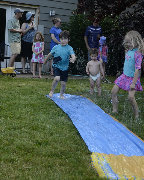 The night before graduation -- celebration party for all of the graduating preschoolers in record one hundred degree heat -- but who minds when there is a slip 'n' slide??