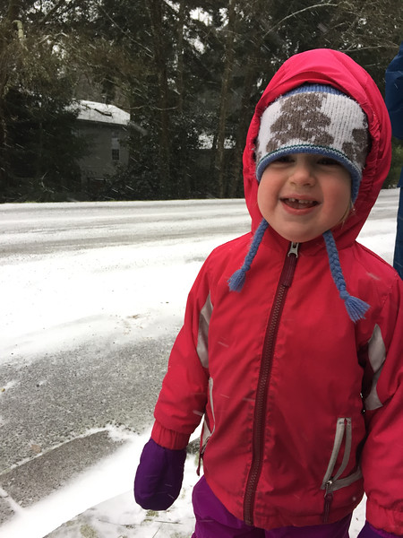 The first snowstorm -- started off winter break 2 days earlier than expected - waiting for big bro at bus stop as the snow starts to fall...