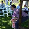 The flower girl makes a beeline for the groom