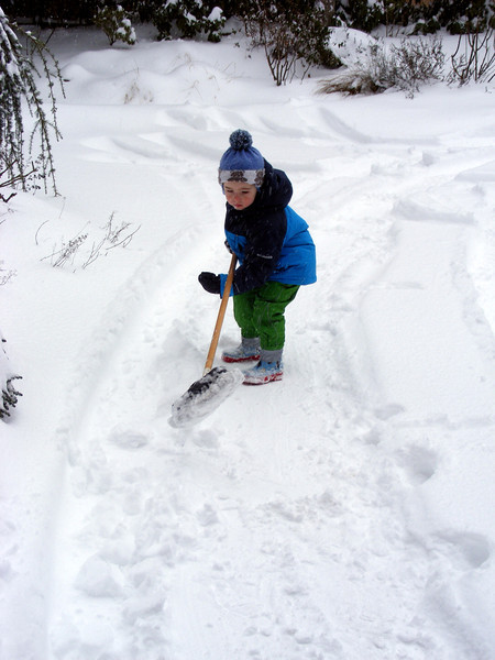 "Helping Daddy to ""clear"" the driveway"