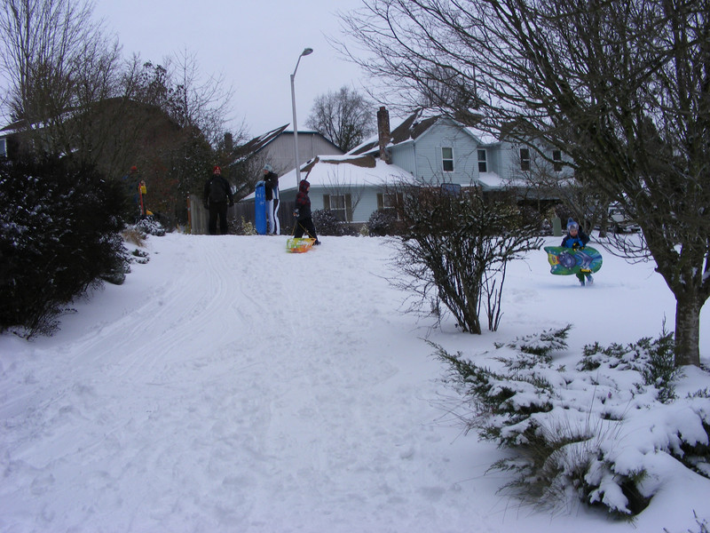 Sledding with our neighbors on our driveway