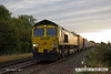 140816-009     Freightliner class 66/5 no 66543 gets a nice golden sheen from the early morning sun, as it passes Frisby, powering diverted Intermodal 4M45, Felixtowe North F.L.T. to Ditton (OConnor).