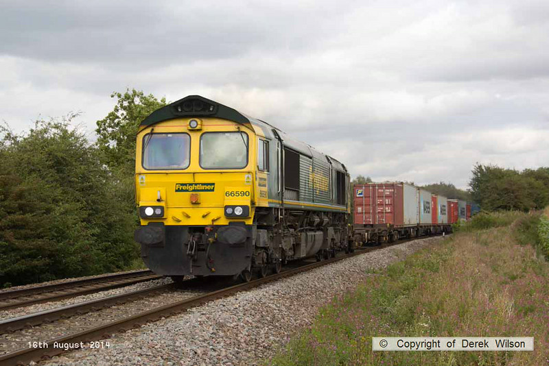140816-049     Freightliner class 66/5 no 66590 passes Hoby, powering diverted Intermodal 4M20, 10.32 Felixstowe north F.L.T. to Lawley Street F.L.T..