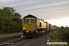 140816-008     Freightliner class 66/5 no 66543 gets a nice golden sheen from the early morning sun, as it passes Frisby, powering diverted Intermodal 4M45, Felixtowe North F.L.T. to Ditton (OConnor).