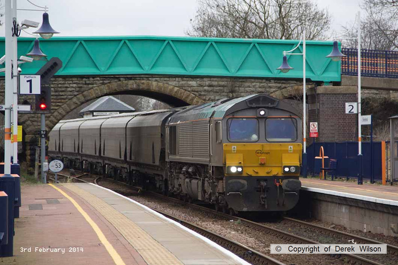 140203-001     On Monday 3rd February 2014, GB Railfreight class 66/7 no 66747 powered train 4D90, the 11.35 Doncaster down decoy to Shirebrook, W.H. Davis, hauling a rake of Drax Power biomass hoppers, and is seen here, arriving at Shirebrook.