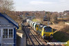 140210-012     Freightliner Heavy Haul class 70 no 70011 is captured passing Thrumpton signal box, at Retford, powering train 6E43, the 07.26 Dowlow to Cottam power station, conveying crushed limestone which is used in the flue-gas desulphurization process.