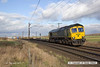 140207-004     Freightliner class 66/6 no 66954 is captured passing Eaton Lane, powering Intermodal service, train 4L85, the 12.28 Doncaster Europort to Felixtowe North.