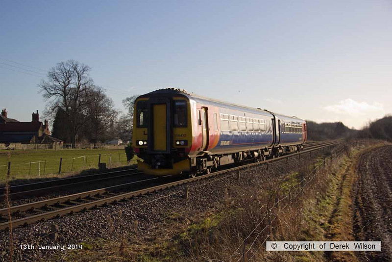 140113-002     East Midlands Trains class 156 unit no 156473 is seen approaching Morton level crossing with 2W12, the 12.26 Nottingham to Worksop.