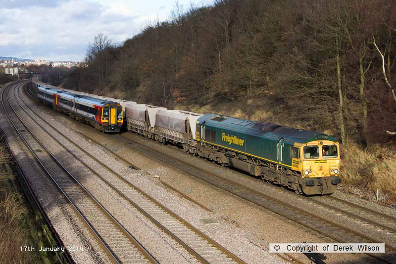 140117-005     Freightliner class 66/6 no 66622 is captured passing Hasland, powering 6M01, the 11.24 Tinsley yard to Bardon Hill quarry,  formed of empty aggregates hoppers. Heading the opposite way are a pair of East Midlands Trains class 158 units with a Norwich to Liverpool service.