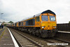 140712-005     GB Railfreight class 66/7 no 66737 Lesia is captured passing through Alfreton with 0X66, 12.00 Newport docks to Doncaster Roberts Road shed, with five new class members in-tow, which are, in order, 66752, 66753, 66754, 66756, and 66755. These are the first of a order for twenty one new loco's to be delivered by the end of the year, and due to new immissions regulations, will be the last of the class to be built. The leading loco, 66737 was built for DRS as 66405 in 2003, so is 11 years older than the new ones.