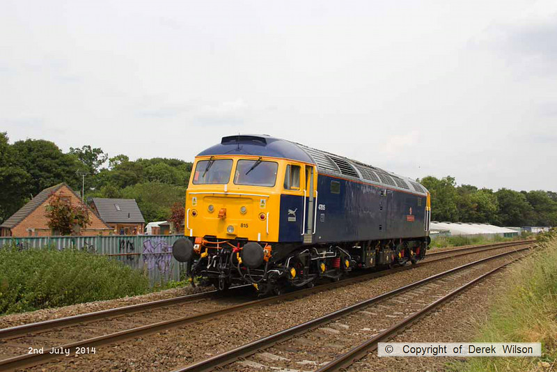 140702-007     GB Railfreight's hired-in class 47/8 n0 47815 Great Western speeds past King's Mill foot crossing with route learner 0Z60, the 13.45 Ironville Junction to Toton Centre.