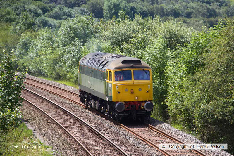 140707-001     Two-tone green liveried class 47/8 no 47812 is seen approaching Kirkby Lane End Junction, where it joined the Robin Hood Line, with GB Railfreight route learner 0Z59, the 12.04 Toton North Yard to Ironville Junction.