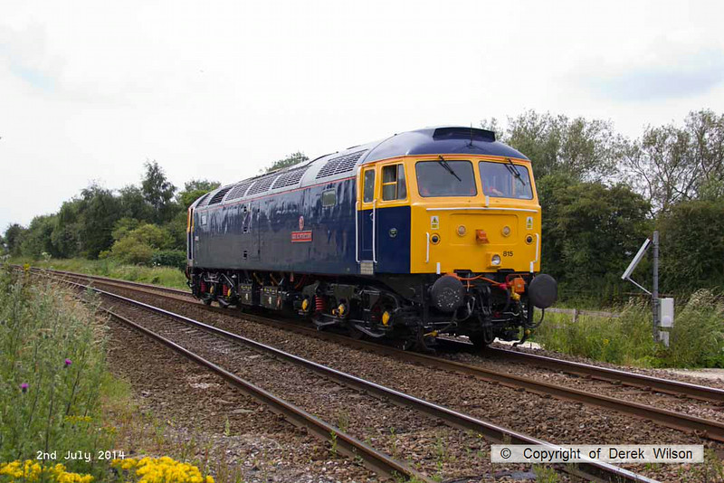 140702-005     GB Railfreight's hired-in class 47/8 n0 47815 Great Western speeds past King's Mill foot crossing with route learner 0Z60, the 13.45 Ironville Junction to Toton Centre.