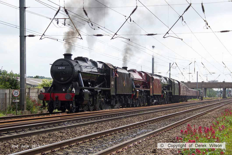 140602-033     Former LMS steam loco's, 8F 2-8-0 no 48151, Jubilee 4-6-0 no 45699 Galatea, and Royal Scot 4-6-0 no 46115 Scots Guardsman are seen approaching Hatchet's Lane foot crossing, as they leave Newark North Gate, with train 5Z70, the 07.59 Dereham to Carnforth (Steamtown). They were returning to base at Carnforth after attending a gala weekend at the Mid Norfolk Railway.