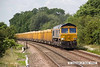 140612-004     GBRailfreight class 66/7 no 66748 Modern Railways The First 50 Years, captured passing Frisby , powering 6L24, the 10.38 Mountsorrel to Whitemoor yard, loaded ballast boxes.