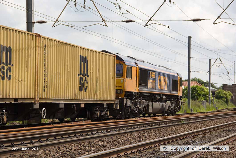 140602-066     GB Railfreight class 66/7 no 66707 Sir Sam Fay powers past Hatchet's Lane foot crossing, Newark, with Intermodal 4L78, the 12.00 Selby to Felixtowe North.