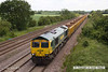 140612-025     Freightliner class 66/5 no 66585 The Drax Flyer  is captured passing Cossington, powering train 6Z87, the Tyne S.S. to Mountsorrel, empty ballast boxes.