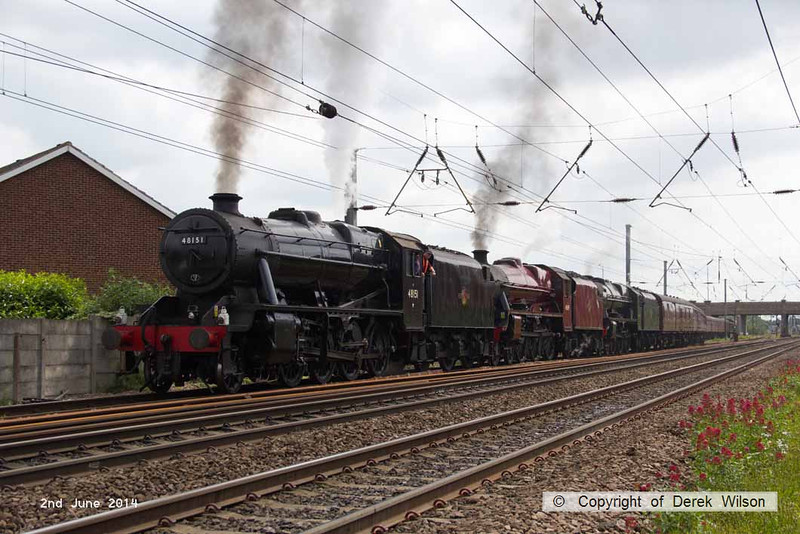 140602-037     Former LMS steam loco's, 8F 2-8-0 no 48151, Jubilee 4-6-0 no 45699 Galatea, and Royal Scot 4-6-0 no 46115 Scots Guardsman are seen approaching Hatchet's Lane foot crossing, as they leave Newark North Gate, with train 5Z70, the 07.59 Dereham to Carnforth (Steamtown). They were returning to base at Carnforth after attending a gala weekend at the Mid Norfolk Railway.