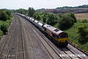 140606-004     DB Schenker class 66/0 no 66027 is captured passing Hasland, Chesterfield, powering 6M11, the 10.00 Washwood Heath to Peak Forest, empty aggregates hoppers.