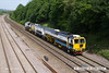 140606-006     Volker Rail track machines, tamper no DR75404 & Ballast regulator no DR77802 are seen passing Hasland, Chesterfield, running as 6XXX, the 09.25 Scunthorpe, Frodingham to Bedford engineers sidings.
