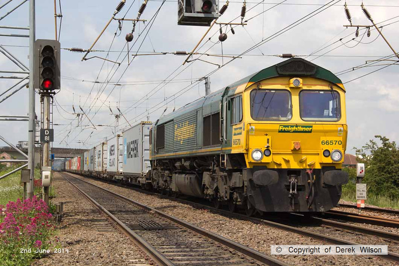 140602-062      Freightliner Heavy Haul class 66/5 no 66570 is seen on the up main, approaching Hatchet's Lane foot crossing, powering Intermodal 4L85, the 12.28 Doncaster Railport to Felixtowe North.