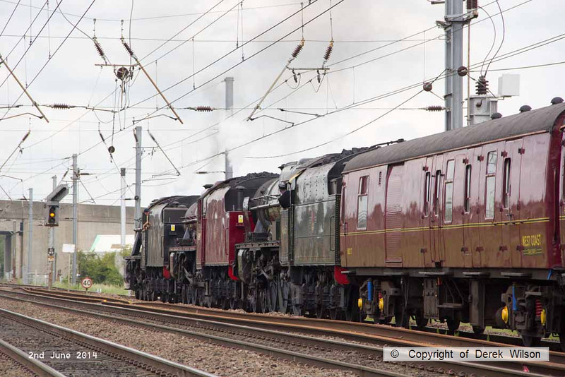 140602-054     Former LMS steam loco's, 8F 2-8-0 no 48151, Jubilee 4-6-0 no 45699 Galatea, and Royal Scot 4-6-0 no 46115 Scots Guardsman are seen crawling up to a light as it changes to amber just in time to avoid having to stop, as they are about to cross over to the down main at Newark, with train 5Z70, the 07.59 Dereham to Carnforth (Steamtown). They were returning to base at Carnforth after attending a gala weekend at the Mid Norfolk Railway.