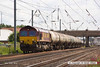140602-069     DB Schenker class 66/0 no 66037 is captured pulling out of Newark North Gate, powering train 6E82, the 12.16 Rectory Junction to Lindsey oil refinery, empty (fuel-oil) bogie tanks.