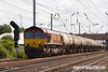 140602-070     DB Schenker class 66/0 no 66037 is captured pulling out of Newark North Gate, powering train 6E82, the 12.16 Rectory Junction to Lindsey oil refinery, empty (fuel-oil) bogie tanks.
