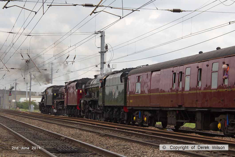140602-051     Former LMS steam loco's, 8F 2-8-0 no 48151, Jubilee 4-6-0 no 45699 Galatea, and Royal Scot 4-6-0 no 46115 Scots Guardsman are seen crawling up to a red light as they are about to cross over to the down main at Newark, with train 5Z70, the 07.59 Dereham to Carnforth (Steamtown). They were returning to base at Carnforth after attending a gala weekend at the Mid Norfolk Railway.