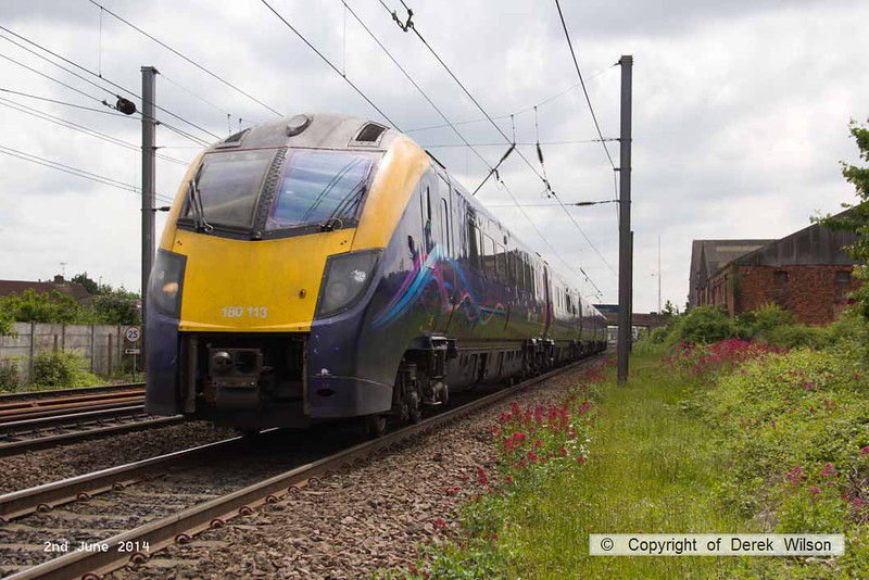 140602-019     Hull Trains class 180, Adelante unit no 180113 passes Hatchet's Lane foot crossing, Newark, with 1H04, the 13.48 London King's Cross to Hull.